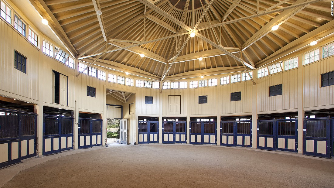 This round, 10-stall barn was built in 1928 and is one of two stables included with the property. There is also a 11,250 sq ft covered riding arena.