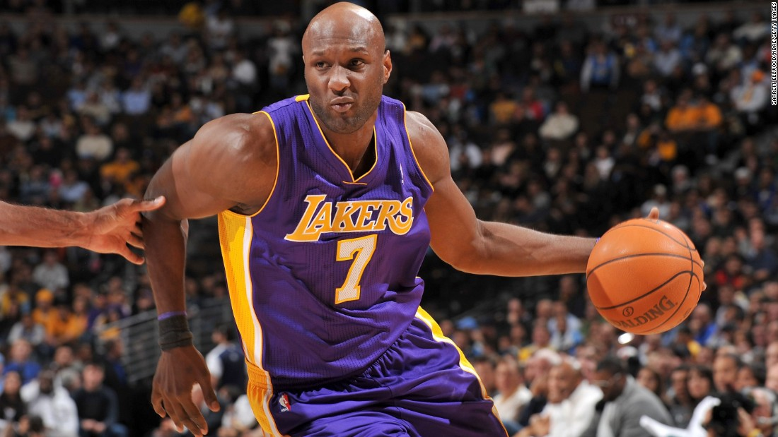 Lamar Odom dribbles the ball during an NBA game against the Denver Nuggets in November 2010. Odom, who won two championships during his career and later married reality TV star Khloe Kardashian, was hospitalized Tuesday, October 13, after he was found unconscious at a brothel in Nevada. On October 19, Odom was transferred to a Los Angeles hospital where he is reportedly breathing on his own.