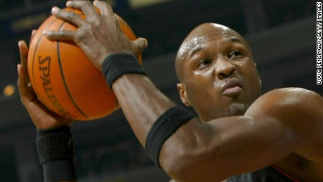 Lamar Odom plays for the Miami Heat against the Washington Wizards in December 2003.