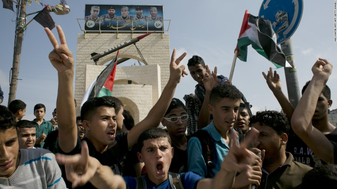 Palestinians take part in an anti-Israel protest in the southern Gaza city of Rafah on October 13.