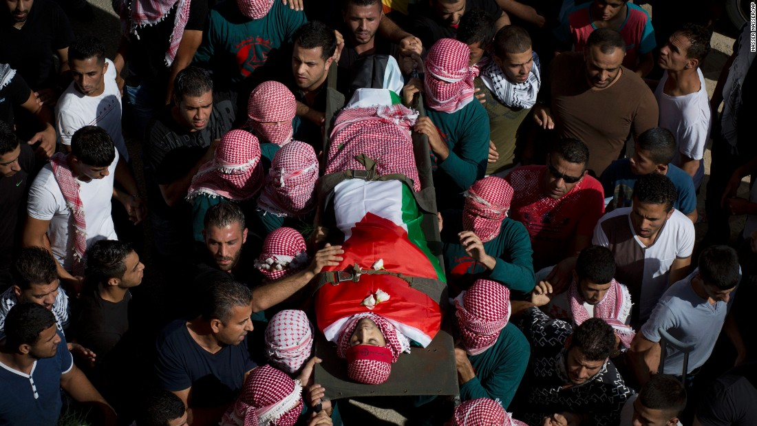 Palestinian mourners carry Zawahra's body on October 14.