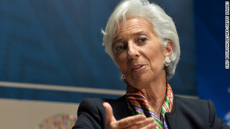 IMF Managing Director Christine Lagarde, takes part in a debate group moderated by British CNN news presenter Richard Quest, and the co-participation of Mark Carney Governor of the Bank of England and Brazilian Minister of Finance Joaquim Levy (neither in picture), on the subject of Debate on the Global Economy during the World Bank Group and International Monetary Fund (IMF) Annual Meetings in Lima, Peru on October 8, 2015.  AFP PHOTO/CRIS BOURONCLE        (Photo credit should read CRIS BOURONCLE/AFP/Getty Images)