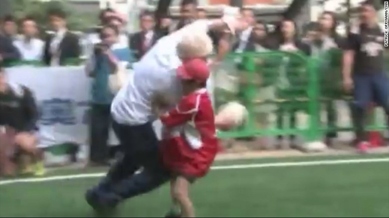 Boris Johnson knocks over boy in rugby game
