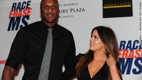 Lamar Odom and Khloe Kardashian-Odom pose on arrival for the 19th Annual Race to Erase MS themed 'Glam Rock to Erase MS' in Los Angeles on May 18, 2012.