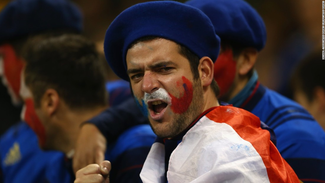 A France fan cheers his country on from the stands but ultimately to little avail.