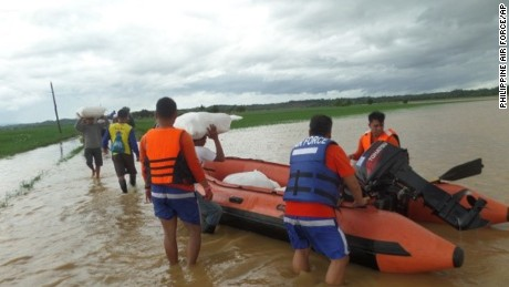 This photo provided by the Philippine Air Force, Philippine Air Force rescue team use rubber boats to distribute relief goods in Isabela province, northern Philippines on Sunday Oct. 18, 2015. Slow-moving Typhoon Koppu weakened after blowing ashore with fierce winds in the northeastern Philippines on Sunday, leaving at least two people dead, displacing 16,000 villagers and knocking out power in entire provinces, officials said.(Philippine Air Force via AP)