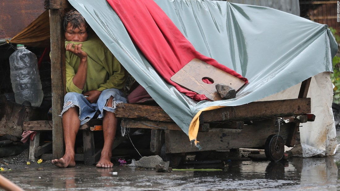 A man sits inside his makeshift home in Navotas on October 18.