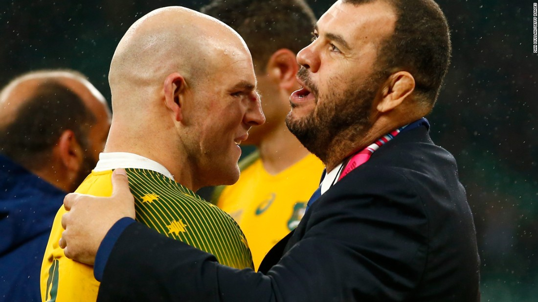 Stephen Moore of Australia celebrates with head coach Michael Cheika after their team's last-gasp victory over Scotland.