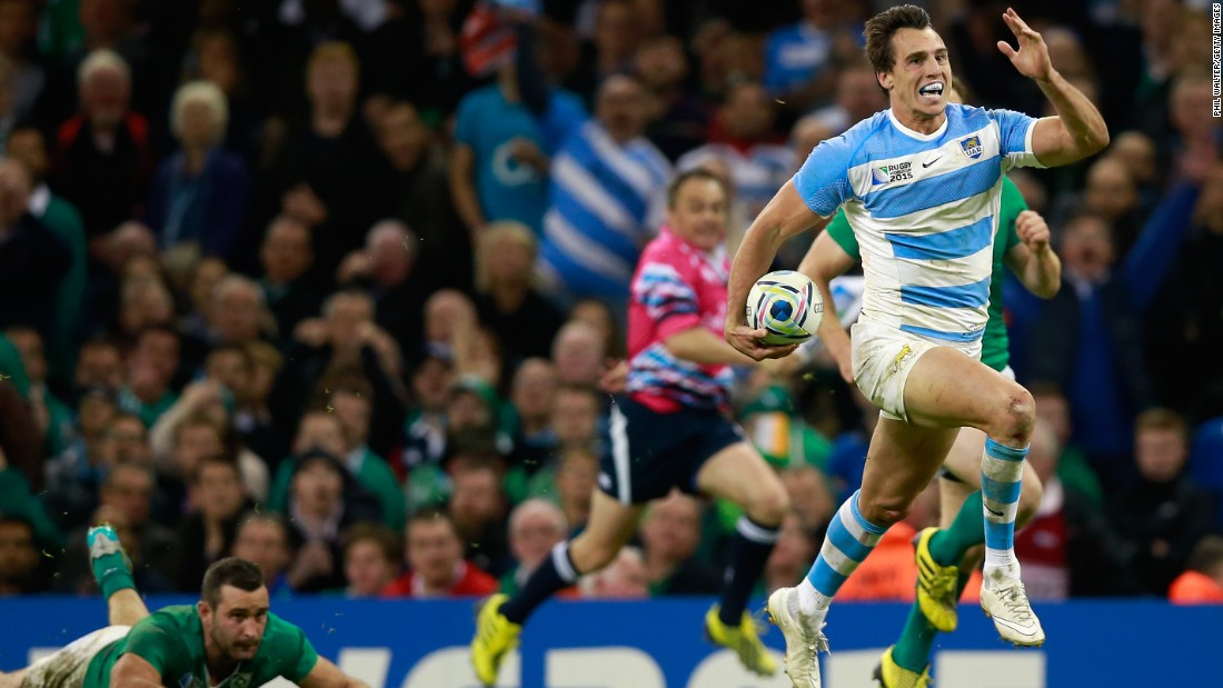 Juan Imhoff of Argentina races clear to score his side's fourth and clinching try in the thumping victory over Ireland in Cardiff.