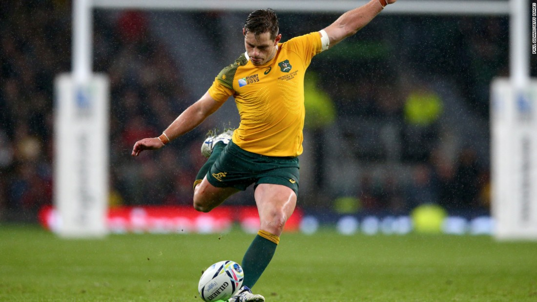 Bernard Foley kicks the match winning penalty for Australia during its one-point victory over Scotland at Twickenham.