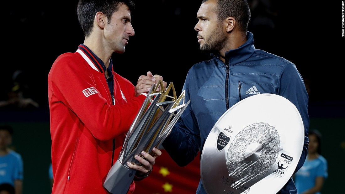 Djokovic and Jo-Wilfried Tsonga pose with their trophies after their men's singles final match in Shanghai.