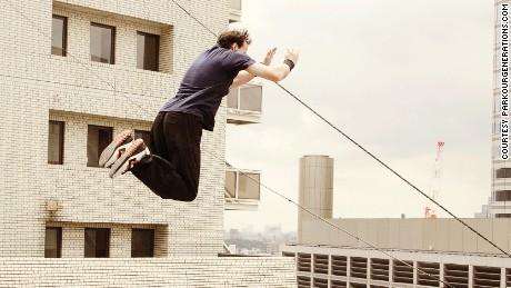 Parkour instructor Dan Edwardes take a spectacular leap in Tokyo.