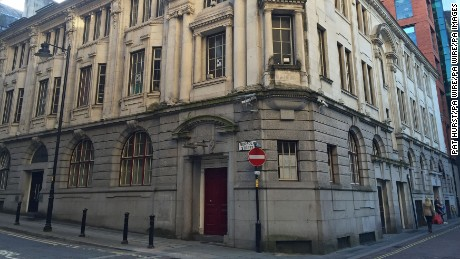 Gary Neville hotel building. The old Stock Exchange building on Norfolk Street in Manchester, as former Manchester United footballer Gary Neville has reportedly offered to let a group of homeless people stay in the building, which he plans to turn into a boutique hotel, for the winter months. Picture date: Monday October 19, 2015. A group under the name of Manchester Angels had been occupying the building since Saturday, and have now said the ex-England full-back has given them permission to stay. See PA story SOCIAL Neville. Photo credit should read: Pat Hurst/PA Wire URN:24473251