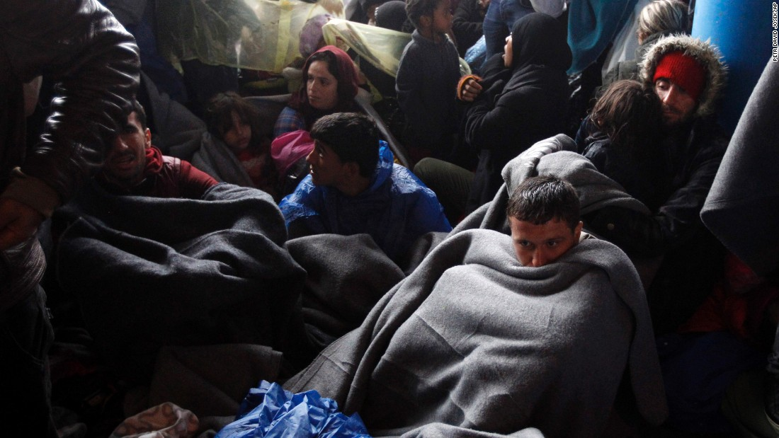 Migrants resting in Trnovec on Monday. Amnesty International criticized governments in the region for allowing the crisis to develop.