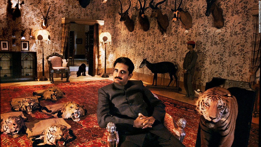 "The water-soaked couple couldn't be more removed from this other-worldly 1996 image of Harshvardhan Singh, son of the  Maharawal of Dungarpur, relaxing at home surrounded by a vast array of exotic taxidermy animals.<br /><br />""McCurry's work represents a genuine panorama of the country, from the Rajasthan desert dust storms to monsoon-flooded Bengali villages, from Kashmir to Kerala,"" says Dalrymple.<br /><br />""His is a world of limpid light, burning colors and darkest shadow, in mood both melancholy and festive. From the massed crowds of Kumbh to a lone woodsman in the Himalayan forest, all Indian humanity is here."""