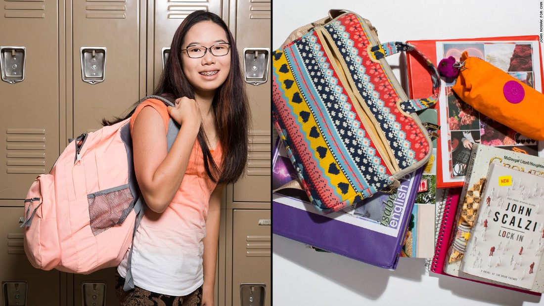 Isabella, a ninth-grade student at Westminster Upper School, said she's gotten used to carrying a heavy backpack, but she would rather use her computer than bulky textbooks.