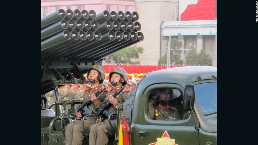 Young members of North Korea's military ride artillery through Pyongyang.