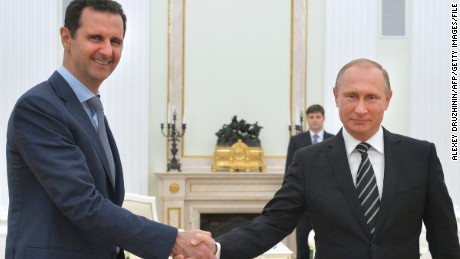 "Russian President Vladimir Putin (R) shakes hands with his Syrian counterpart Bashar al-Assad (L) during a meeting at the Kremlin in Moscow on October 21, 2015. Assad, on his first foreign visit since Syria's war broke out, told his main backer and counterpart Putin in Moscow that Russia's campaign in Syria has helped contain ""terrorism"". AFP PHOTO / RIA NOVOSTI / KREMLIN POOL / ALEXEY DRUZHININ        (Photo credit should read ALEXEY DRUZHININ/AFP/Getty Images)"