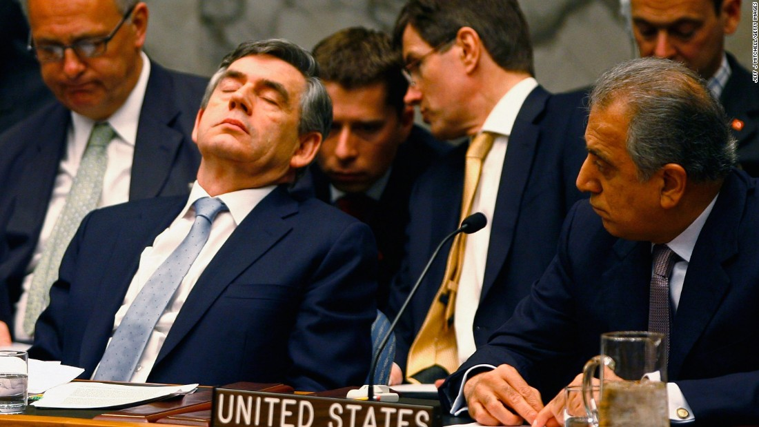 "Then-British Prime Minister Gordon Brown (L) ""rests his eyes"" during a U.N. Security Council meeting in New York in April 2008."