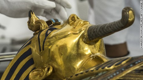 German specialists in restoration work on antiquities in glass and metal Christian Eckmann works on the restoration process of the golden mask of Tutankhamun at the Egyptian Museum in Cairo on October 20, 2015. Egypt started work to remove a crust of dried glue on the beard of legendary boy pharaoh Tutankhamun's golden mask after a botched repair job on the priceless relic. The beard fell off in an August 2014 accident at the Cairo Museum, leading to the botched repair by employees. AFP PHOTO / KHALED DESOUKI        (Photo credit should read KHALED DESOUKI/AFP/Getty Images)