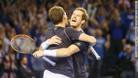 GLASGOW, UNITED KINGDOM - SEPTEMBER 19: Andy Murray celebrates with his brother Jamie as they beat Lleyton Hewitt and Sam Groth of Australia during day 2 of the Great Britain v Australia Davis Cup Semi Final 2015 at the Emirates Arena on September 19, 2015 in Glasgow, United Kingdom. (Photo by Steve Welsh/Getty Images)