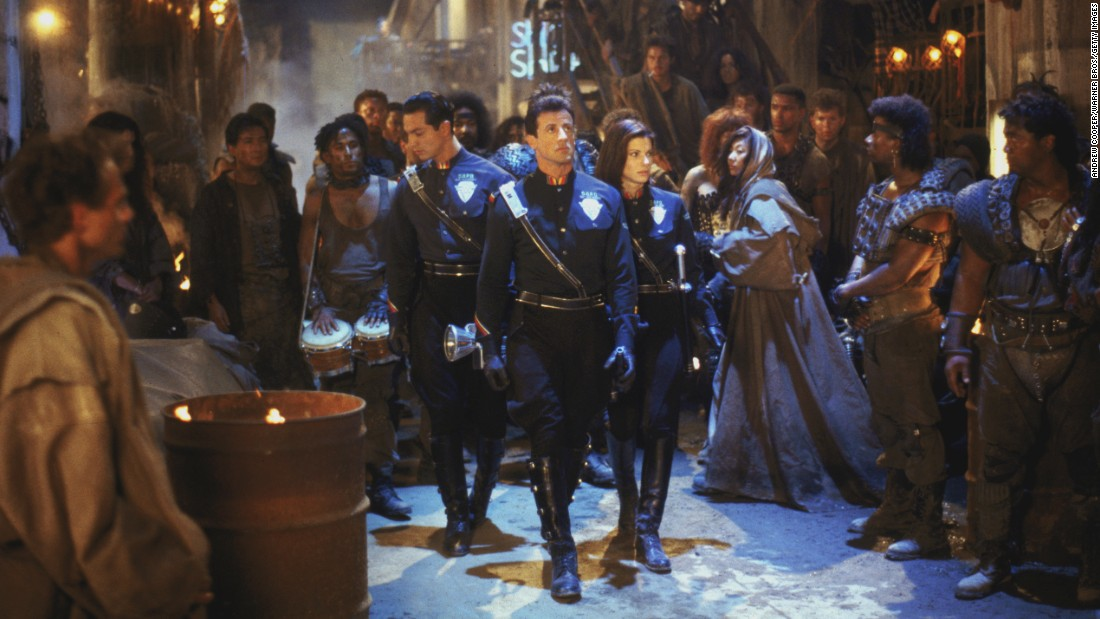 "In 1993's ""Demolition Man,"" cop Sylvester Stallone ends up in 2032 when he's freed from a cryogenic state to take on archvillain Wesley Snipes. Benjamin Bratt and Sandra Bullock also star. One conceit of the movie: Taco Bell is the only restaurant left."