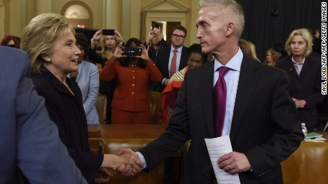 Former Secretary of State and Democratic Presidential hopeful Hillary Clinton (L) shakes hands with Republican US Representative from South Carolina Trey Gowdy  after she testified before the House Select Committee on Benghazi on Capitol Hill in Washington, DC, October 22, 2015.