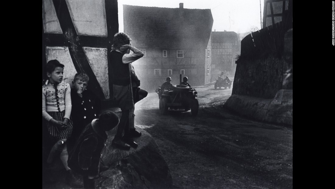 German children watch a vehicle of the U.S. 9th Armored Division pass through their village during the Allied drive toward Berlin in March 1945. Photographer John Florea directed some of the most famous American TV shows of the 1960s, '70s and '80s, but he spent his early years as a photographer on the bloody battlefields World War II.