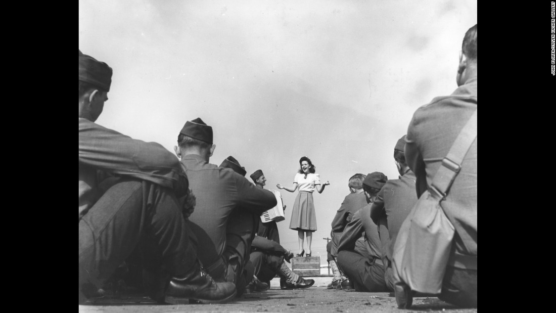 American actress Marilyn Hare performs for soldiers at a U.S. Army training camp in California as they wait for food on February 5, 1942.