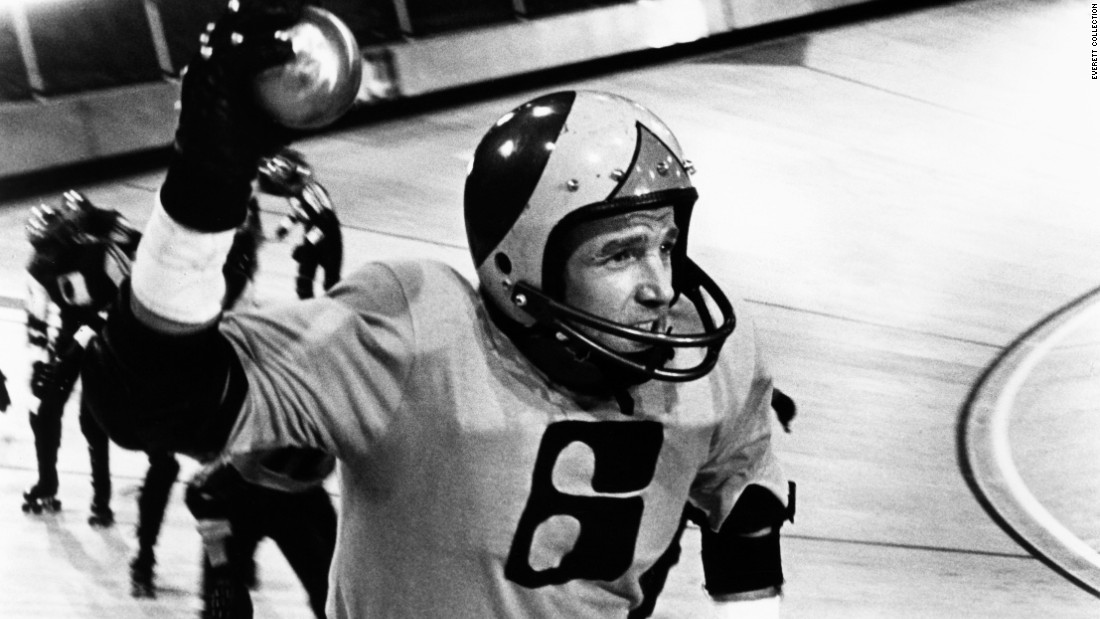 """Rollerball"" (1975) stars James Caan as an elite athlete in 2018. Corporations run the world, and everything is calm and luxurious -- except the sport of Rollerball, which lets the public vent its bloodlust. They love Caan's character, but the ruling executives aren't fond of his individualism."
