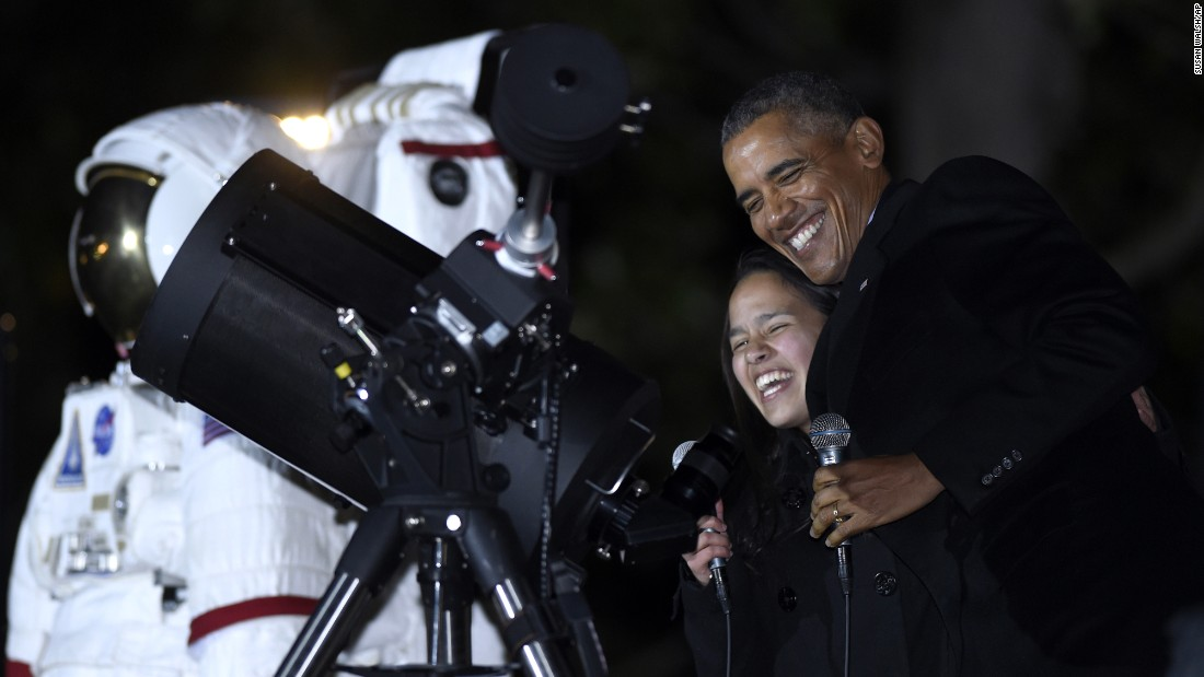 President Obama shares a laugh with Agatha Sofia Alvarez-Bareiro, a high-school senior from New York, as he prepares to look at the moon during White House Astronomy Night on Monday, October 19. The event brought together students, teachers, astronomers, engineers, scientists and space enthusiasts for an evening of stargazing.