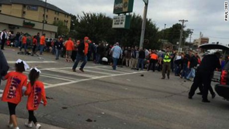 car hits crowd Oklahoma State homecoming parade nr_00000000.jpg
