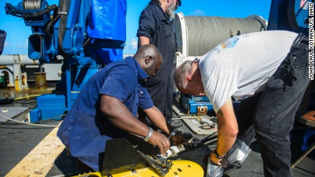 Members of the El Faro search team prepare the tow pinger locater aboard the USNS Apache in the Bahamas on October 23, 2015.