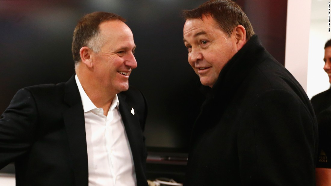 All Blacks coach Steve Hansen (right) and New Zealand Prime Minister John Key chat in the dressing room after the semifinal against South Africa.