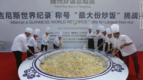 More than 300 people churned out 4,192 kilograms of fried rice, a signature cuisine from the of Yangzhou on October 22, 2015.