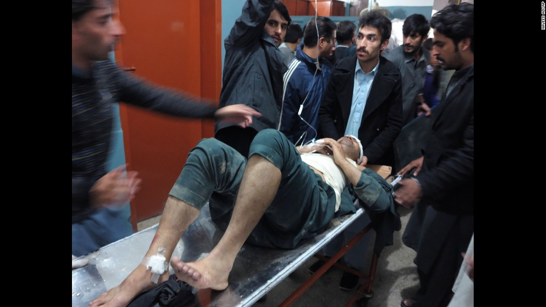 A man is brought to a hospital in Mingora, Pakistan, on October 26.