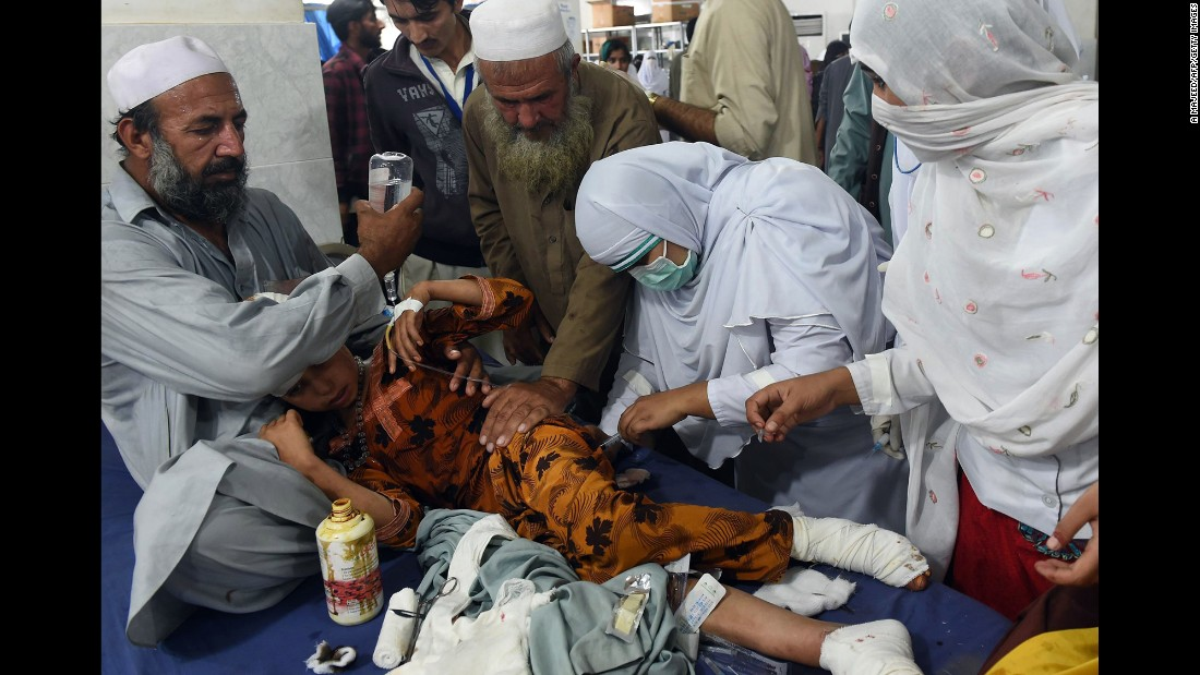Paramedics treat an injured girl at a hospital in Peshawar.