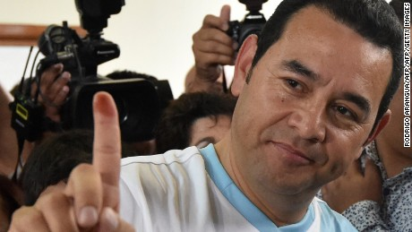 Guatemalan presidential candidate for the National Front Convergence Jimmy Morales shows his inked finger after casting his vote in Mixco, near Guatemala City on October 25, 2015. Guatemalans vote in a presidential run-off choosing between a comedian with no political experience and a former first lady, amid the fallout of a massive corruption scandal. AFP PHOTO / RODRIGO ARANGUA        (Photo credit should read RODRIGO ARANGUA/AFP/Getty Images)