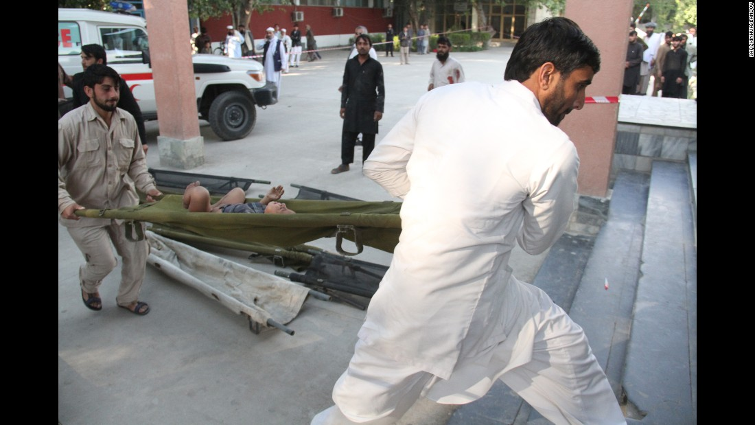 People transfer an injured child to a hospital in Jalalabad, Afghanistan.
