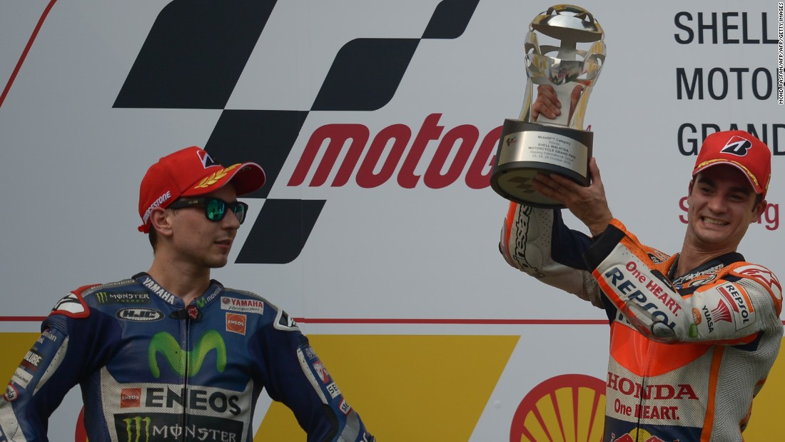 Jorge Lorenzo (left), who finished second in Malaysia behind Repsol Honda's resurgent Dani Pedrosa, is now just seven points behind Rossi in the world championship. Rossi is seeking a 10th title.