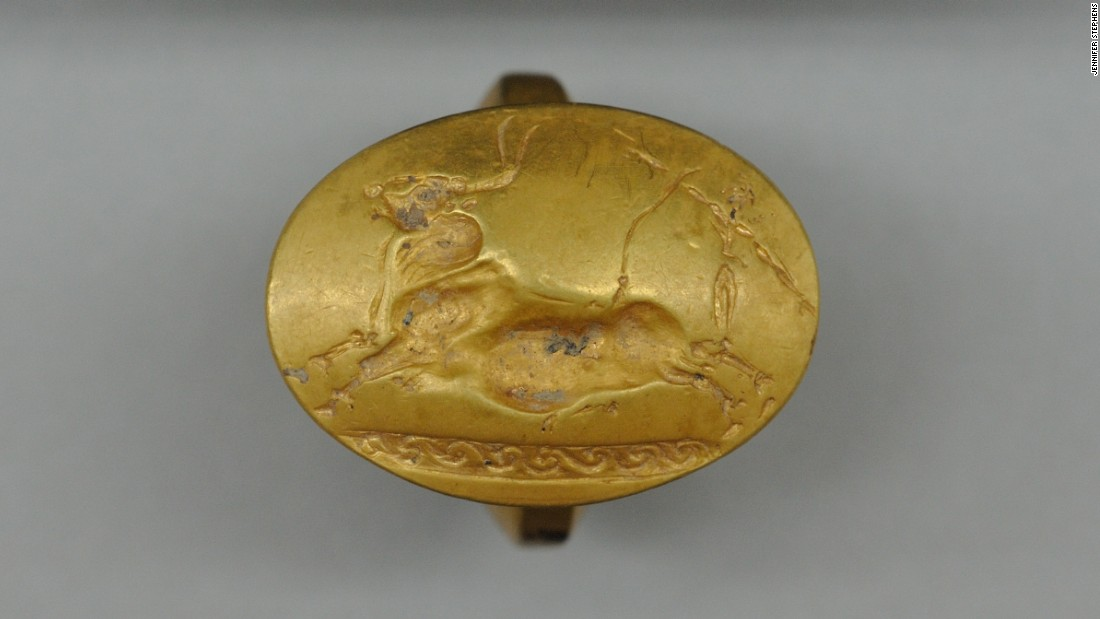Four solid-gold rings were found in the tomb -- more than have been found at any single burial site elsewhere in Greece, according to the archaeologists. This one depicts a Cretan bull running scene.