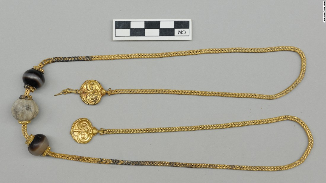 "This 30-inch necklace, with two gold pendants decorated with ivy leaves, was found near the neck of the warrior-king's skeleton. ""Nothing like this has ever been found,"" said Jack Davis, co-leader of the University of Cincinnati team which discovered the site."