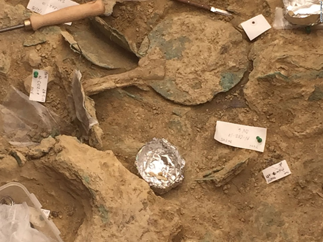 "A bronze mirror with an ivory handle. Greece's general secretary of the Ministry of Culture Maria Vlazaki said it was ""extremely rare for an unlooted tomb of such great significance to be unearthed."""