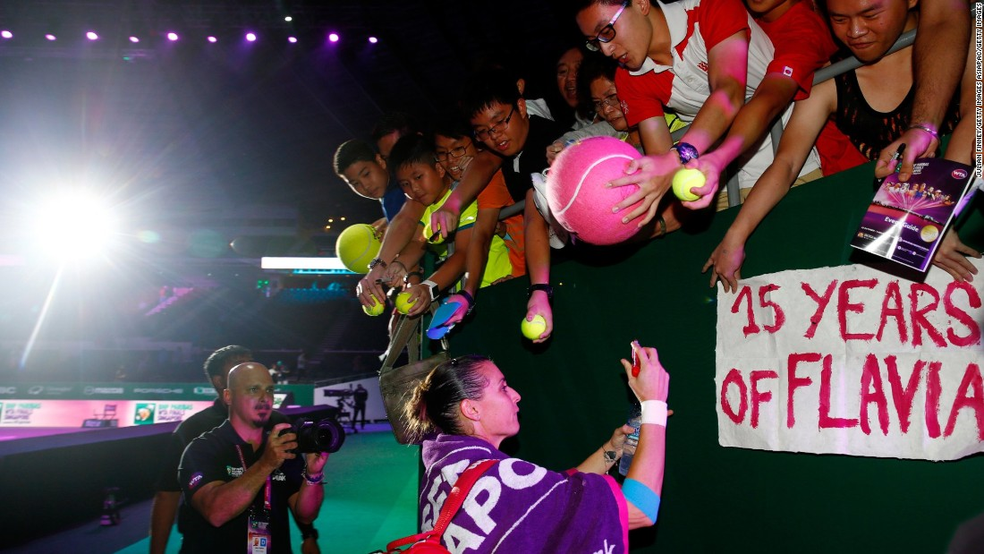Pennetta signs autographs for fans after defeating Radwanska  7-6 (7-5) 6-4 in Tuesday's earlier Red Group match. Italy's U.S. Open champion kept her semifinal hopes alive ahead of her closing match against Sharapova.