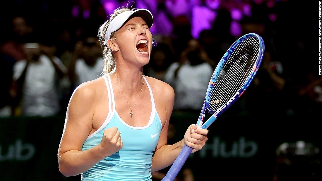 Sharapova celebrates after beating top seed Halep 6-4 6-4 in their second Red Group round-robin match in Singapore.