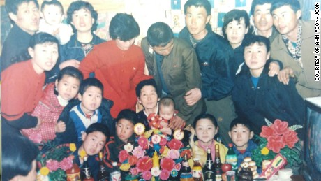 Ahn Yoon-Ae, center, with her families.