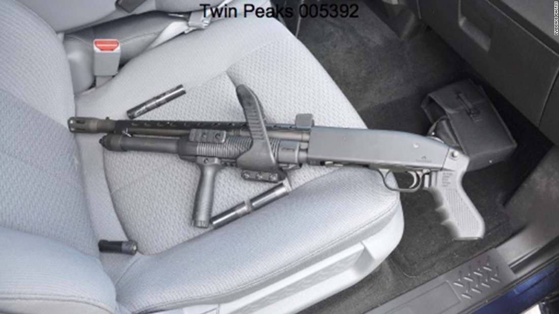 A gun is seen in the passenger seat of a car.