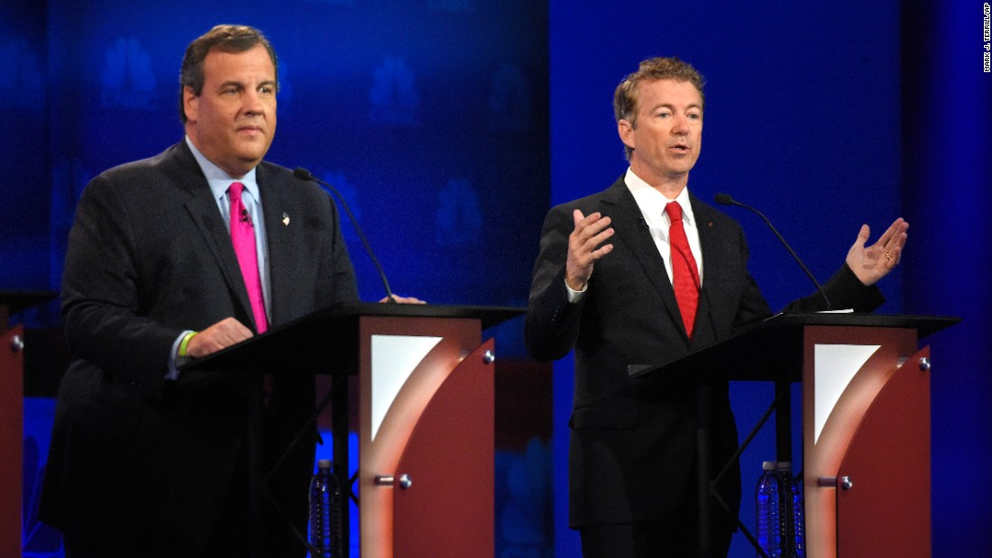 "Rand Paul, right, speaks as Chris Christie looks on. Paul said, ""If you're not willing to gradually raise the age, you're not serious about"" fixing Social Security and Medicare. On the same topic, Christie hit the Democrats for making big promises. ""When they say they want to give it to you free, keep your hand on your wallet,"" he said."