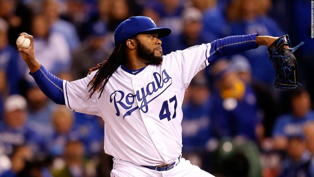 Johnny Cueto of the Royals throws a pitch in the first inning against the New York Mets.