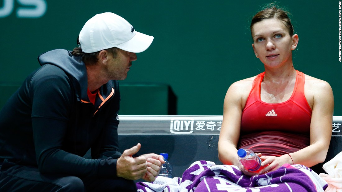 A frustrated Halep, seen here with coach Darren Cahill, fell 7-6 (7-5) 6-1. The Romanian was the highest ranked player in the field at No. 2.
